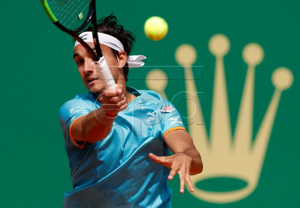 Lorenzo Sonego of Italy in action during his quarterfinal match against Dusan Lajovic of Serbia at the Monte-Carlo Rolex Masters tournament in Roquebrune Cap Martin, France, 19 April 2018.  EPA-EFE/SEBASTIEN NOGIER