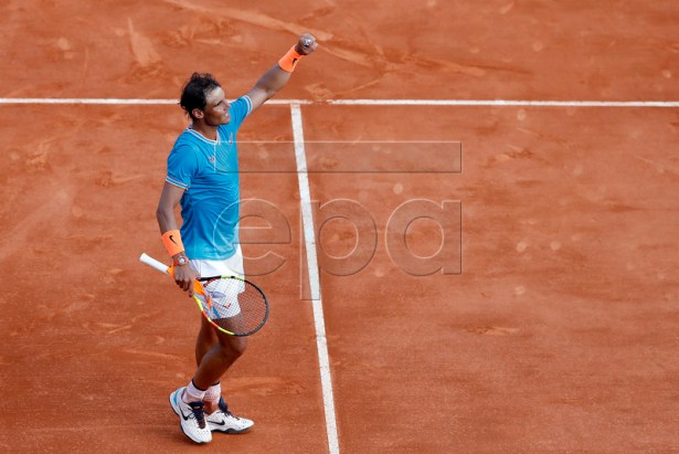 Rafael Nadal of Spain celebrates winning against Guido Pella of Argentina during their quarter final match at the Monte-Carlo Rolex Masters tournament in Roquebrune Cap Martin, France, 19 April 2018. EPA-EFE/SEBASTIEN NOGIER