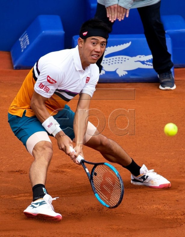 Kei Nishikori of Japan in action against Felix Auger-Aliassime of Canada during their third round men's single match of the 67th Barcelona Open Trofeo Conde de Godo tennis tournament in Barcelona, Spain, 25 April 2019.  EPA-EFE/Enric Fontcuberta