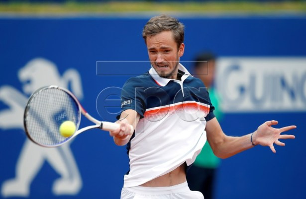 Daniil Medvedev of Russia in action against Dominic Thiem of Austria during their final men's single match of the 67th Barcelona Open Trofeo Conde de Godo tennis tournament in Barcelona, Spain, 28 April 2019.  EPA-EFE/ALEJANDRO GARCIA
