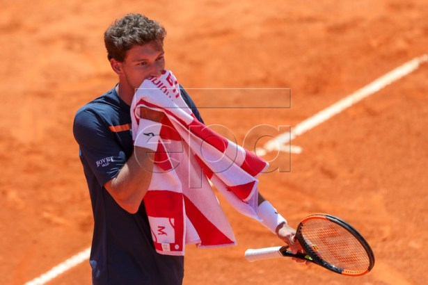 Pablo Carreno-Busta from Spain reacts during his first round match against Jeremy Chardy from France at the Estoril Open Tennis tournament in Cascais, near Lisbon, Portugal, 30 April 2019.  EPA-EFE/JOSE SENA GOULAO
