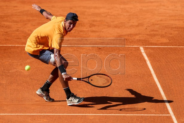 Alexei Popyrin from Australia in action during his first round match against  Joao Sousa from Portugal at the Estoril Open Tennis tournament in Cascais, near Lisbon, Portugal, 30 April 2019.  EPA-EFE/JOSE SENA GOULAO