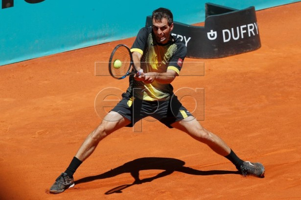 Spanish player Albert Ramos in action during his qualifying match against Japan's Taro Daniel at the Mutua Madrid Open tennis tournament in Madrid, Spain, 04 May 2019. EPA-EFE/CHEMA MOYA