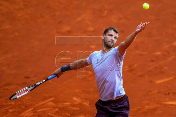 Grigor Dimitrov of Bulgaria in action against Taylor Fritz of the USA during their first round match of the Mutua Madrid Open tennis tournament at the Caja Magica complex in Madrid, Spain, 06 May 2019.  EPA-EFE/JUANJO MARTIN
