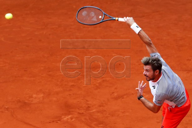 Stan Wawrinka of Switzerland in action against Pierre-Hugues Herbert of France during their first round match of the Mutua Madrid Open tennis tournament at the Caja Magica complex in Madrid, Spain, 07 May 2019.  EPA-EFE/CHEMA MOYA