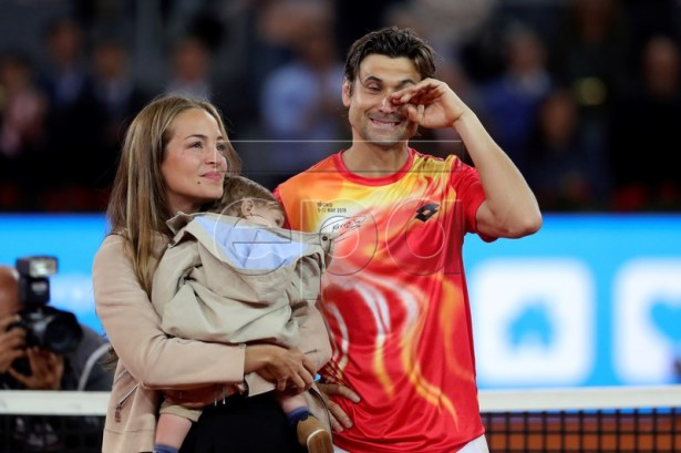 Spanish David Ferrer (R), accompanied by his wife Marta Tornel (L), receives a tribute after his Mutua Madrid Open's tournament round of 32 game against German Alexander Zverev played at Caja Magica tennis complex, in Madrid, Spain, 08 May 2019. This has been the last match of Ferrer as a professional tennis player. EPA-EFE/JUANJO MARTIN