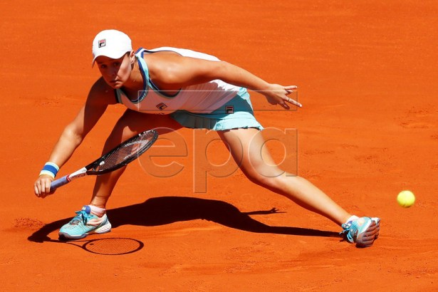 Ashleigh Barty of Australia in action against Simona Halep of Romania during their quarter final match of the Mutua Madrid Open tennis tournament at the Caja Magica complex in Madrid, Spain, 09 May 2019. EPA-EFE/CHEMA MOYA