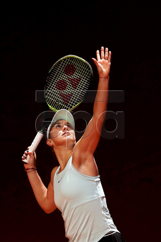 Belinda Bencic of Switzerland in action against Naomi Osaka of Japan during their quarter final match of the Mutua Madrid Open tennis tournament at the Caja Magica complex in Madrid, Spain, 09 May 2019.  EPA-EFE/KIKO HUESCA