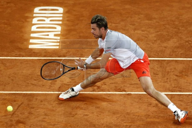 Swiss tennis player Stan Wawrinka in action against Rafal Nadal of Spain during their quarterfinal match played at the Mutua Madrid Open tennis tournament in Madrid, Spain, 10 May 2019.  EPA-EFE/JAVIER LIZON