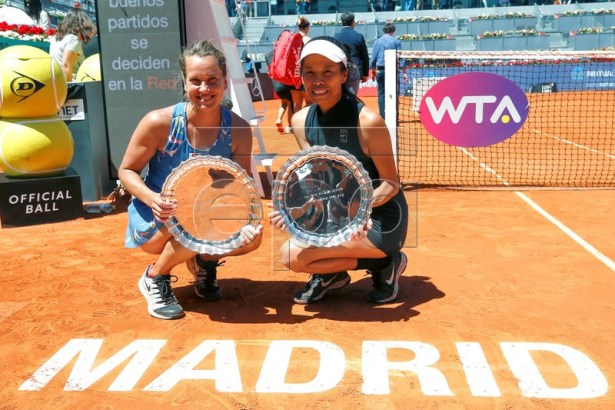 Tennis players Su-Wei Hsieh (R) from Taiwan and Barbora Strycova (L) from Czech Republic pose with their trophies after winning their women's doubles final against  Gabriela Dabrowski of Canada and Yifan Xu of China at the Mutua Madrid Open tennis tournament in Madrid, Spain, 11 May 2019.  EPA-EFE/CHEMA MOYA