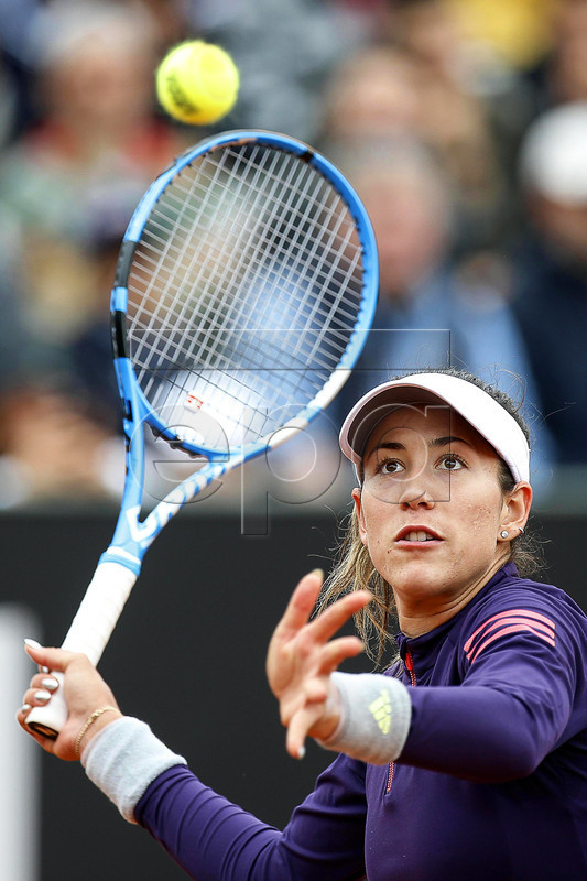 Garbine Muguruza of Spain in action against Zheng Saisai of China during their women's singles first round match at the Italian Open tennis tournament in Rome, Italy, 13 May 2019.  EPA-EFE/RICCARDO ANTIMIANI