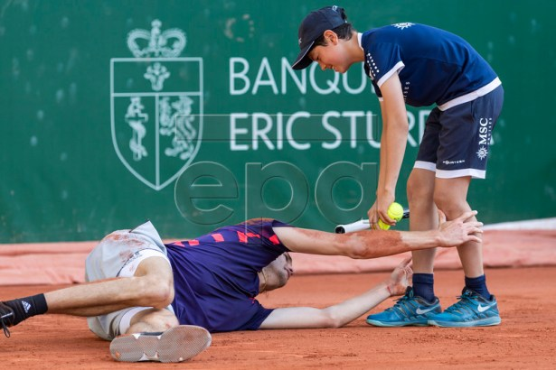 Alexander Zverev of Germany clings on to a ball boy's legs after falling during his quarter final match against Alexander Zverev of Germany at the Geneva Open tennis tournament in Geneva, Switzerland, 23 May 2019.  EPA-EFE/MARTIAL TREZZINI