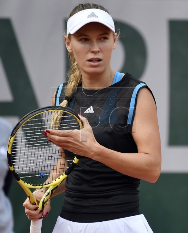 Caroline Wozniacki of Denmark plays Veronika Kudermetova of Russia during their women?s first round match during the French Open tennis tournament at Roland Garros in Paris, France, 27 May 2019.  EPA-EFE/JULIEN DE ROSA