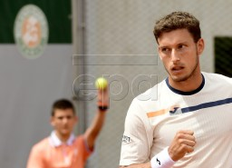 Pablo Carreno Busta of Spain plays Joao Sousa of Portugal during their men?s first round match during the French Open tennis tournament at Roland Garros in Paris, France, 27 May 2019. EPA-EFE/CAROLINE BLUMBERG