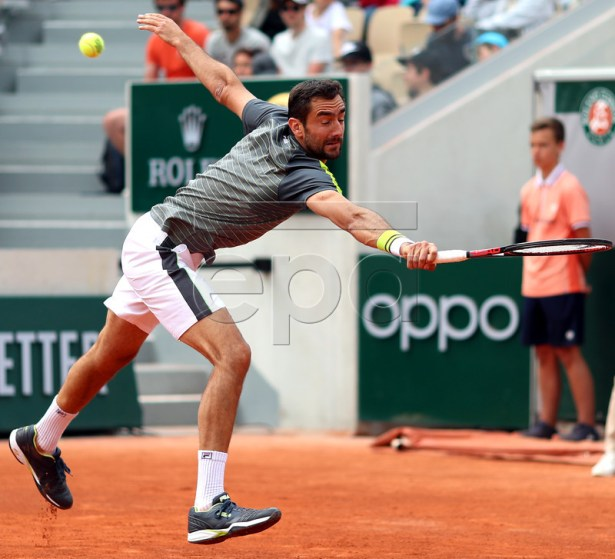 Marin Cilic of Croatia plays Grigor Dimitrov of Bulgaria during their men?s second round match during the French Open tennis tournament at Roland Garros in Paris, France, 29 May 2019.  EPA-EFE/SRDJAN SUKI