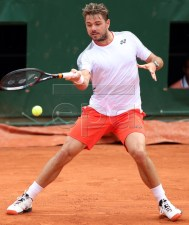 Stan Wawrinka of Switzerland plays Cristian Garin of Chile  during their men?s second round match during the French Open tennis tournament at Roland Garros in Paris, France, 29 May 2019.  EPA-EFE/SRDJAN SUKI