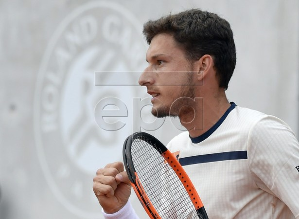 Pablo Carreno Busta of Spain plays Alex De Minaur of Australia  during their men?s second round match during the French Open tennis tournament at Roland Garros in Paris, France, 29 May 2019.  EPA-EFE/SRDJAN SUKI