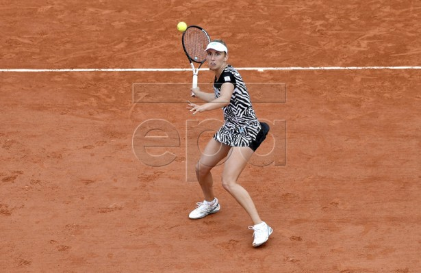 Elise Mertens of Belgium plays Anastasija Sevastova of Latvia during their women?s third round match during the French Open tennis tournament at Roland Garros in Paris, France, 31 May 2019. EPA-EFE/JULIEN DE ROSA