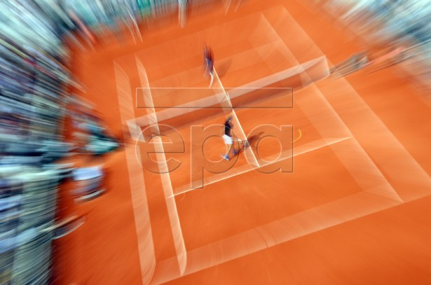 Alexander Zverev of Germany (front) plays Fabio Fognini of Italy during their men?s round of 16 match during the French Open tennis tournament at Roland Garros in Paris, France, 03 June 2019. EPA-EFE/SRDJAN SUKI