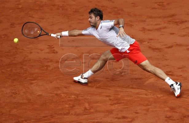 Stan Wawrinka of Switzerland plays Roger Federer of Switzerland during their men?s quarter final match during the French Open tennis tournament at Roland Garros in Paris, France, 04 June 2019. EPA-EFE/YOAN VALAT