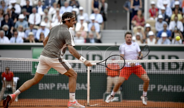 Roger Federer of Switzerland (L) plays Stan Wawrinka of Switzerland during their men?s quarter final match during the French Open tennis tournament at Roland Garros in Paris, France, 04 June 2019. EPA-EFE/JULIEN DE ROSA