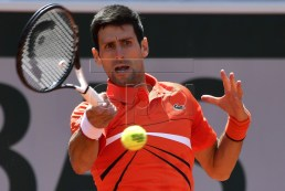 Novak Djokovic of Serbia plays Alexander Zverev of Germany during their men?s quarter final match during the French Open tennis tournament at Roland Garros in Paris, France, 06 June 2019.  EPA-EFE/JULIEN DE ROSA