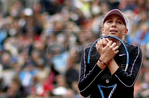 Amanda Anisimova of the USA reacts as she plays Ashleigh Barty of Australia during their women?s semi final match during the French Open tennis tournament at Roland Garros in Paris, France, 07 June 2019. EPA-EFE/YOAN VALAT