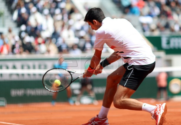 Novak Djokovic of Serbia plays Dominic Thiem of Austria during their men?s semi final match during the French Open tennis tournament at Roland Garros in Paris, France, 08 June 2019. EPA-EFE/SRDJAN SUKI