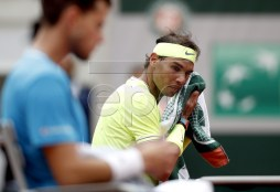 Rafael Nadal of Spain reacts during a break as he plays Dominic Thiem of Austria during their men?s final match during the French Open tennis tournament at Roland Garros in Paris, France, 09 June 2019. EPA-EFE/YOAN VALAT