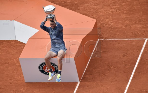 Rafael Nadal of Spain poses with the trophy after winning the men?s final match against Dominic Thiem of Austria during the French Open tennis tournament at Roland Garros in Paris, France, 09 June 2019. Nadal won the French Open title 12th times. EPA-EFE/JULIEN DE ROSA