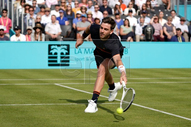 Britain Cameron Norrie returns to Kevin Anderson of South Africa during their round 32 match at the Fever Tree Championship at Queen's Club in London, Britain, 17 June 2019. The tournament runs from 17th June till 23 June 2019. EPA-EFE/WILL OLIVER