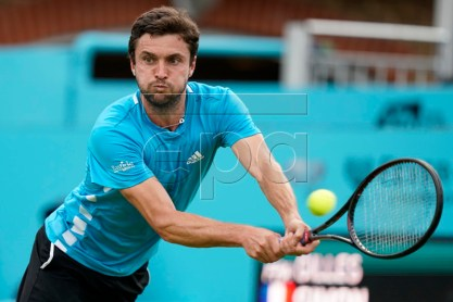 France's Gilles Simon returns to Britain's James Ward during their round 32 match at the Fever Tree Championship at Queen's Club in London, Britain, 17 June 2019. The tournament runs from 17th June till 23 June 2019 EPA-EFE/WILL OLIVER