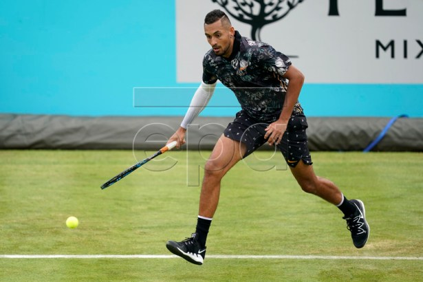 Australia's Nick Kyrgios returns to Spain's Roberto Carballes Baena during their round 32 match at the Fever Tree Championship at Queen's Club in London, Britain, 20 June 2019. EPA-EFE/WILL OLIVER