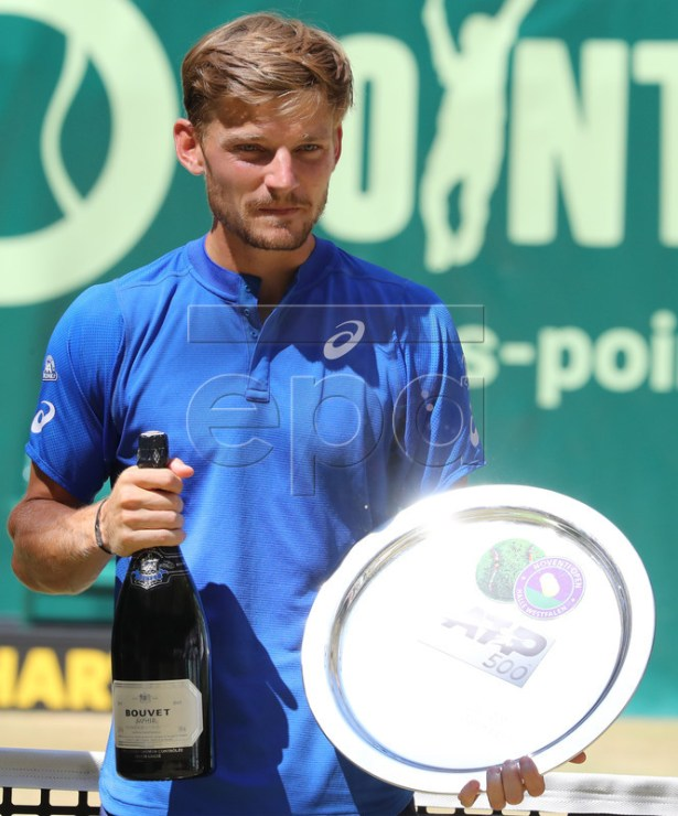 David Goffin from Belgium poses with the runner-up trophy after the final match against Roger Federer from Switzerland at the ATP Tennis Tournament Noventi Open (former Gerry Weber Open) in Halle Westphalia, Germany, 23 June 2019. EPA-EFE/FOCKE STRANGMANN