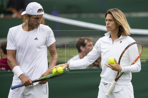 Lucas Pouille of France (L) talks to his coach Amelie Mauresmo during a training session at the All England Lawn Tennis Championships in Wimbledon, London, Britain, 26 June 2019. The Wimbledon Tennis Championships 2019 will be held in London from 01 July to 14 July 2019. EPA-EFE/PETER KLAUNZER EDITORIAL USE ONLY; NO SALES, NO ARCHIVES