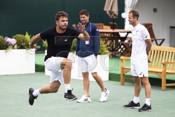 Stan Wawrinka (L) of Switzerland and his coaches Magnus Norman (R) and Daniel Vallverdu (C) attend a training session at the All England Lawn Tennis Championships in Wimbledon, London, Britain, 26 June 2019. The Wimbledon Tennis Championships 2019 will be held in London from 01 July to 14 July 2019. EPA-EFE/PETER KLAUNZER EDITORIAL USE ONLY/NO SALES/NO ARCHIVES