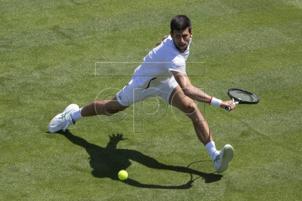 Novak Djokovic of Serbia hits a ball during a training session at the All England Lawn Tennis Championships in Wimbledon, London, on Thursday, June 27, 2019. EPA-EFE/PETER KLAUNZER EDITORIAL USE ONLY; NO SALES, NO ARCHIVES