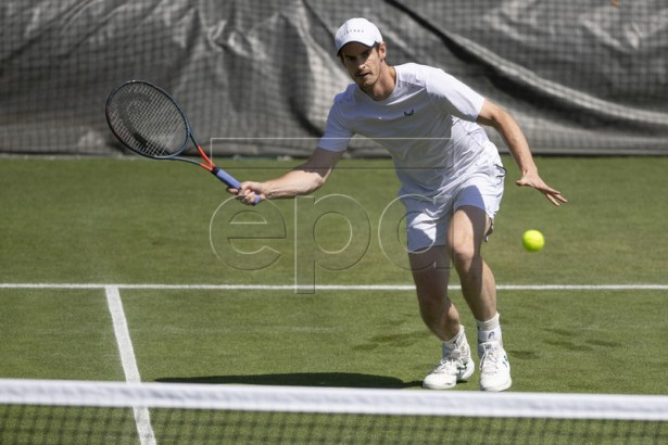 Andy Murray of Great Britain hits a ball during a training session at the All England Lawn Tennis Championships in Wimbledon, London, on Thursday, June 27, 2019. EPA-EFE/PETER KLAUNZER EDITORIAL USE ONLY; NO SALES, NO ARCHIVES