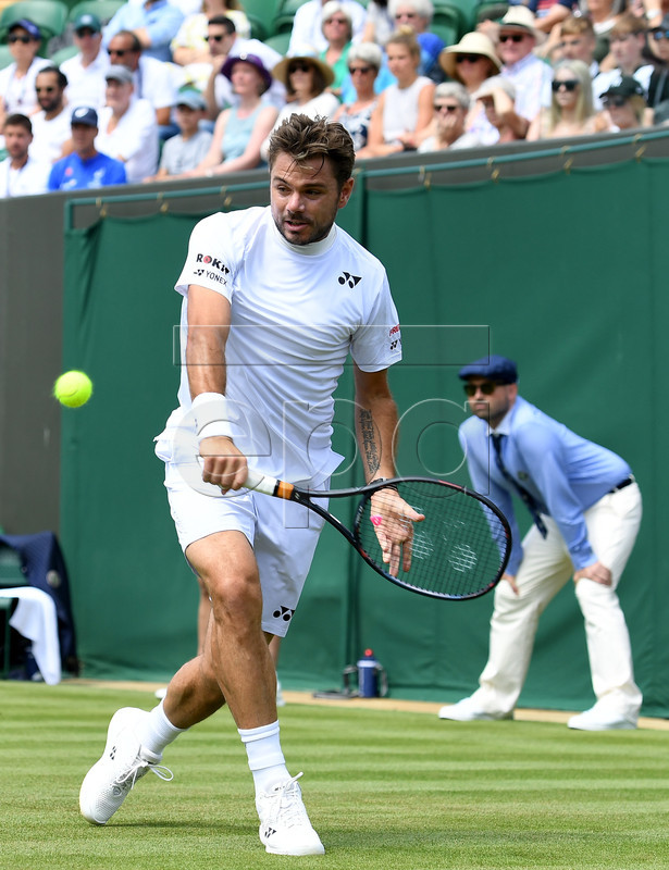 Stan Wawrinka of Switzerland in action against Ruben Bemelmans of Belgium during their first round match at the Wimbledon Championships at the All England Lawn Tennis Club, in London, Britain, 01 July 2019. EPA-EFE/ANDY RAIN EDITORIAL USE ONLY/NO COMMERCIAL SALES