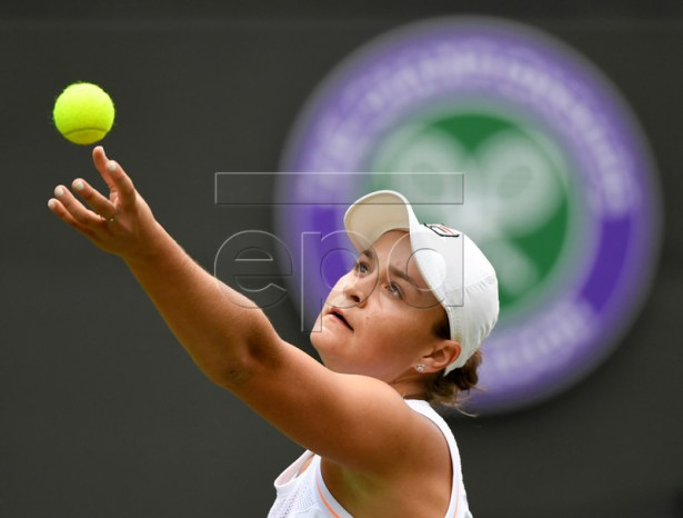 Ashleigh Barty of Australia in action against Saisai Zheng of China during their first round match at the Wimbledon Championships at the All England Lawn Tennis Club, in London, Britain, 02 July 2019 EPA-EFE/FACUNDO ARRIZABALAGA EDITORIAL USE ONLY/NO COMMERCIAL SALES