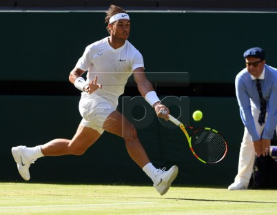 Rafael Nadal of Spain returns to Nick Kyrgios of Australia in their second round match during the Wimbledon Championships at the All England Lawn Tennis Club, in London, Britain, 04 July 2019. EPA-EFE/FACUNDO ARRIZABALAGA EDITORIAL USE ONLY/NO COMMERCIAL SALES
