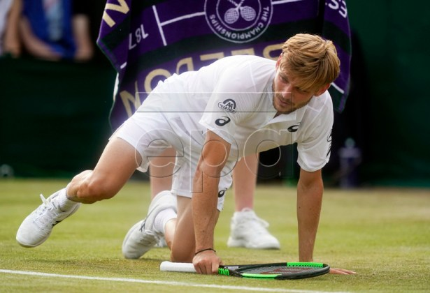 David Goffin of Belgium takes a fall as he plays Daniil Medvedev of Russia in their third round match during the Wimbledon Championships at the All England Lawn Tennis Club, in London, Britain, 05 July 2019. EPA-EFE/WILL OLIVER EDITORIAL USE ONLY/NO COMMERCIAL SALES