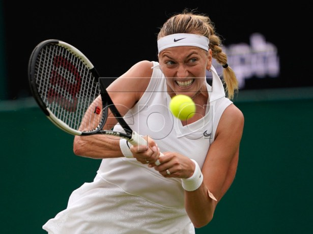 Petra Kvitova of the Czech Republic in action against Magda Linette of Poland during their third round match at the Wimbledon Championships at the All England Lawn Tennis Club, in London, Britain, 06 July 2019. EPA-EFE/NIC BOTHMA EDITORIAL USE ONLY/NO COMMERCIAL SALES