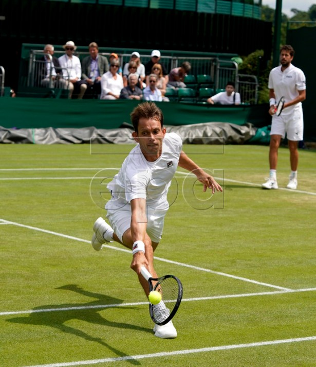 Robin Haase (R) of the Netherlands and Frederik Nielsen of Denmark in action against Raven Klaasen of South Africa and Michael Venus of New Zealand during their Men's Doubles match at the Wimbledon Championships at the All England Lawn Tennis Club, in London, Britain, 08 July 2019. EPA-EFE/WILL OLIVER EDITORIAL USE ONLY/NO COMMERCIAL SALES