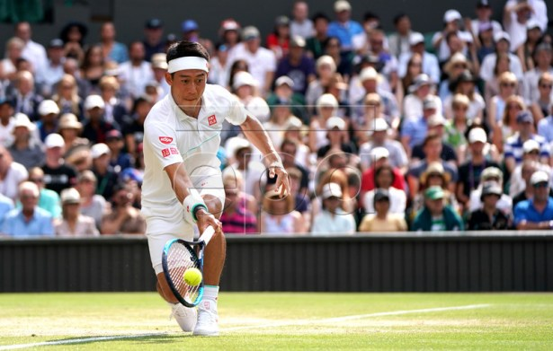 Kei Nishikori of Japan in action against Roger Federer of Switzerland during their quarter final match for the Wimbledon Championships at the All England Lawn Tennis Club, in London, Britain, 10 July 2019. EPA-EFE/NIC BOTHMA EDITORIAL USE ONLY/NO COMMERCIAL SALES