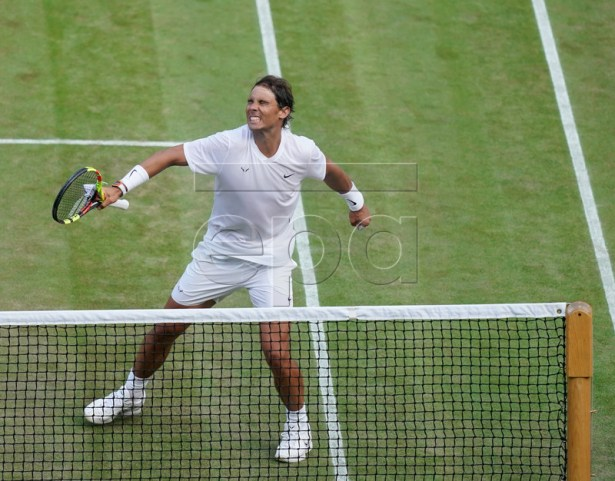 Rafael Nadal of Spain celebrates winning against Sam Querrey of the USA in their quarter final match during the Wimbledon Championships at the All England Lawn Tennis Club, in London, Britain, 10 July 2019. EPA-EFE/WILL OLIVER EDITORIAL US