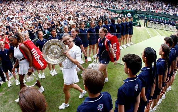 Simona Halep (C) of Romania celebrates with the trophy after winning against Serena Williams of the USA during their final match for the Wimbledon Championships at the All England Lawn Tennis Club, in London, Britain, 13 July 2019. EPA-EFE/NIC BOTHMA EDITORIAL USE ONLY/NO COMMERCIAL SALES