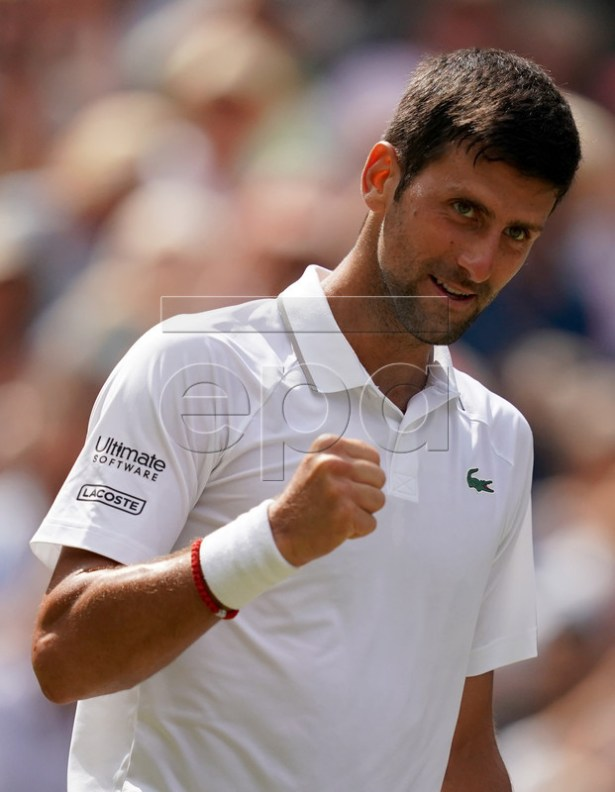 Novak Djokovic of Serbia celebrates winning against Roberto Bautista Agut of Spain during their semi final match for the Wimbledon Championships at the All England Lawn Tennis Club, in London, Britain, 12 July 2019. EPA-EFE/WILL OLIVER EDITORIAL USE ONLY/NO COMMERCIAL SALES