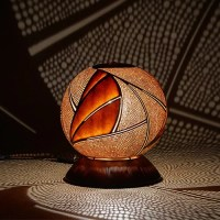 Calabarte's unique gourd lamps create a mesmerizing ...