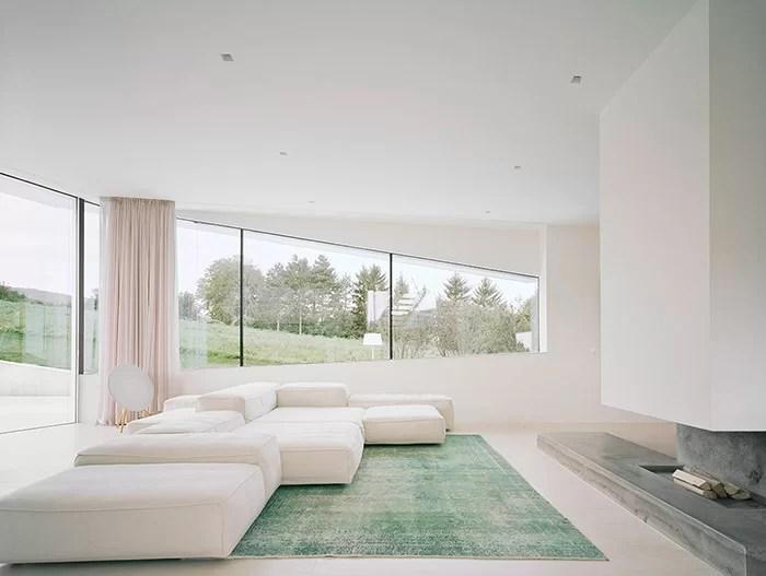Freundorf Residence Futuristic allwhite house near